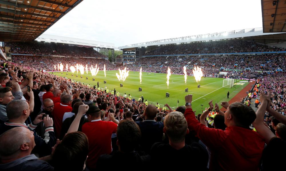 The teams take to the pitch.