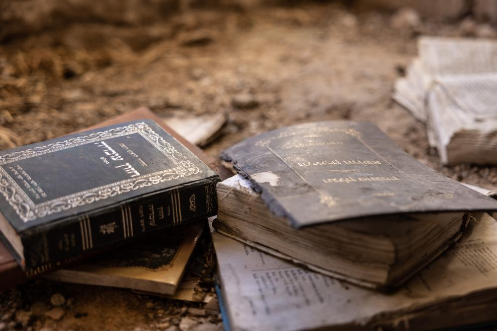 Religious books are scattered on the floor in one of Lifta's houses. Former residents say that people have previously gathered there for religious studies.