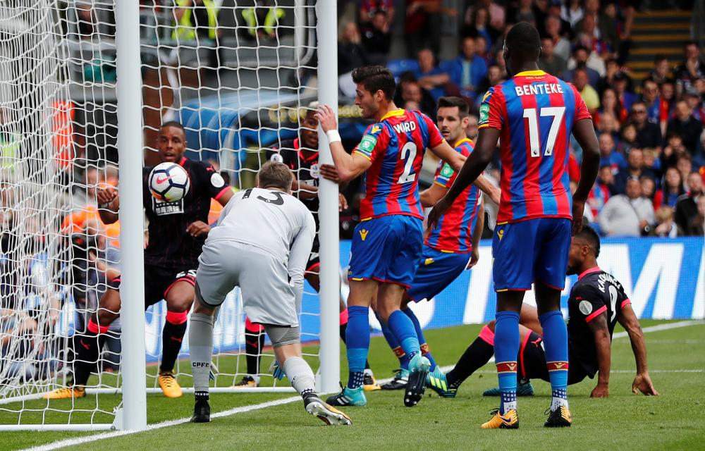 Crystal Palace's Joel Ward scores an own goal.