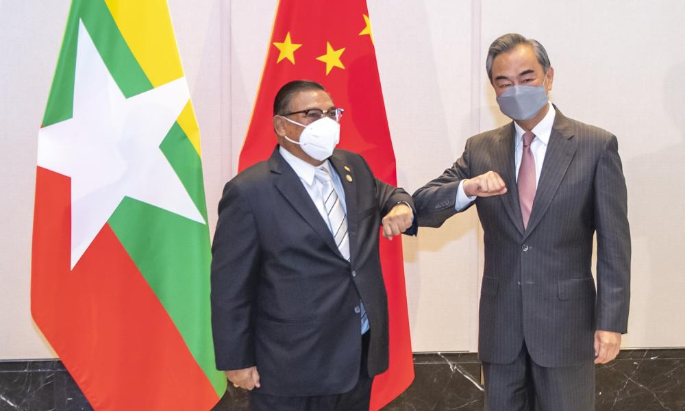 Chinese Foreign Minister Wang Yi at right bumps elbows with with Myanmar's Foreign Minister U Wunna Maung Lwin during one of the meetings marking the 30th anniversary of formal relations between China and ASEAN on 8 June, 2021.