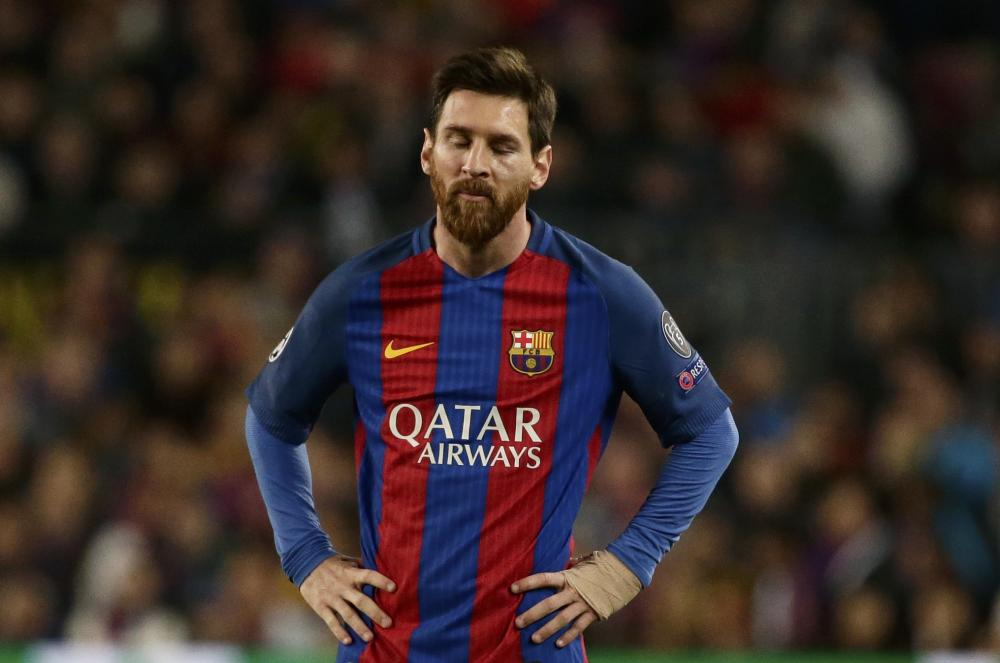 Dejected Messi reacts after the final whistle.