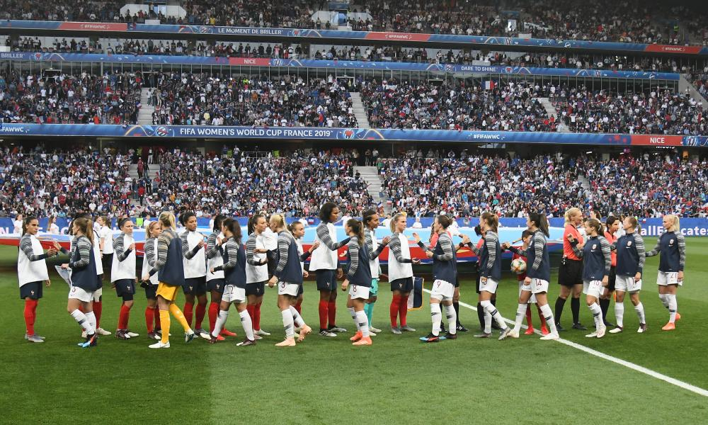 The France and Norway teams shake hands before kick-off in front of packed stands in Nice