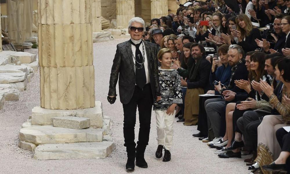 Karl Lagerfeld and Hudson Kroenig on the catwalk for Chanel cruise collection.