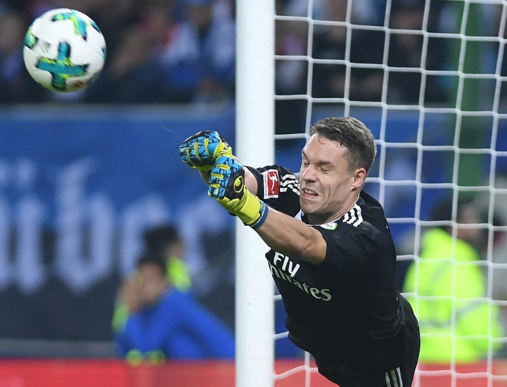 Hamburg goalkeeper Christian Mathenia beats a shot away.