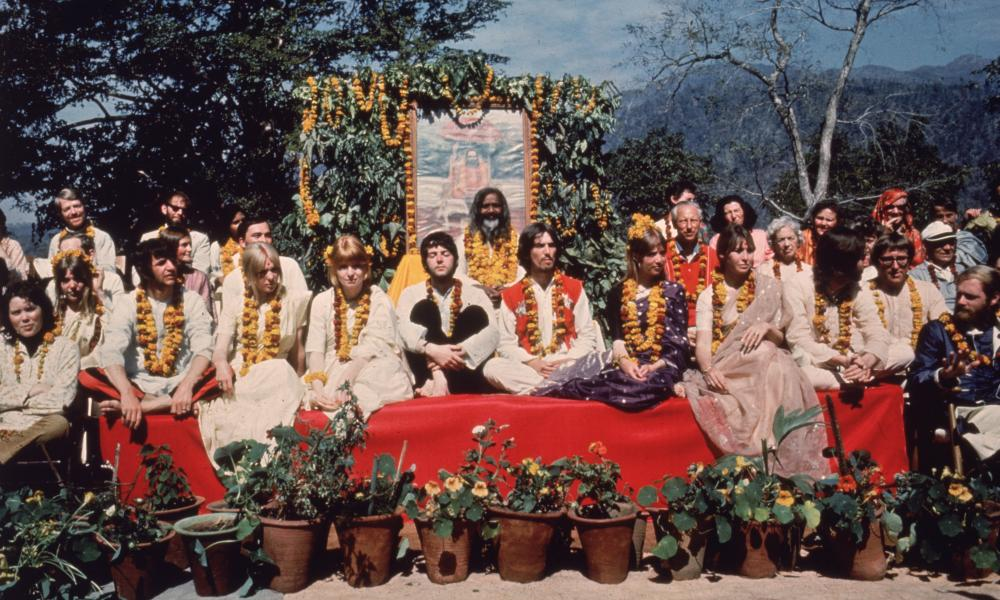 The Beatles and their wives and girlfriends at the Rishikesh in India with the Maharishi Mahesh Yogi. The group includes Ringo Starr, Maureen Starkey, Jane Asher, Paul McCartney, George Harrison, Patti Boyd, Cynthia Lennon, John Lennon.
