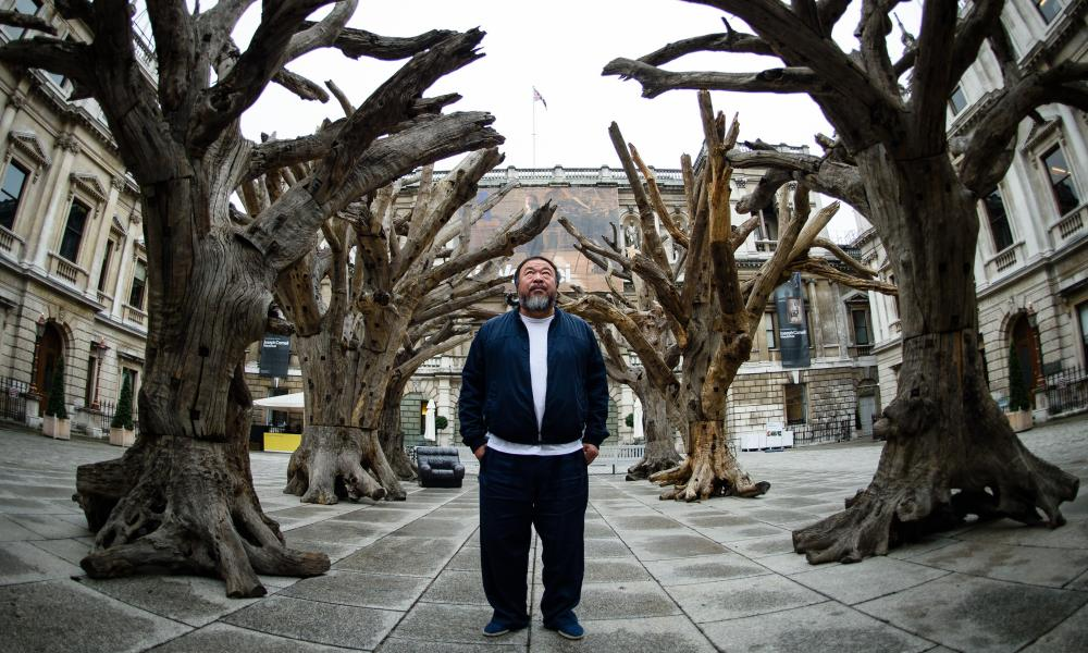Ai Weiwei pictured in London, 2015, with his creation named Tree