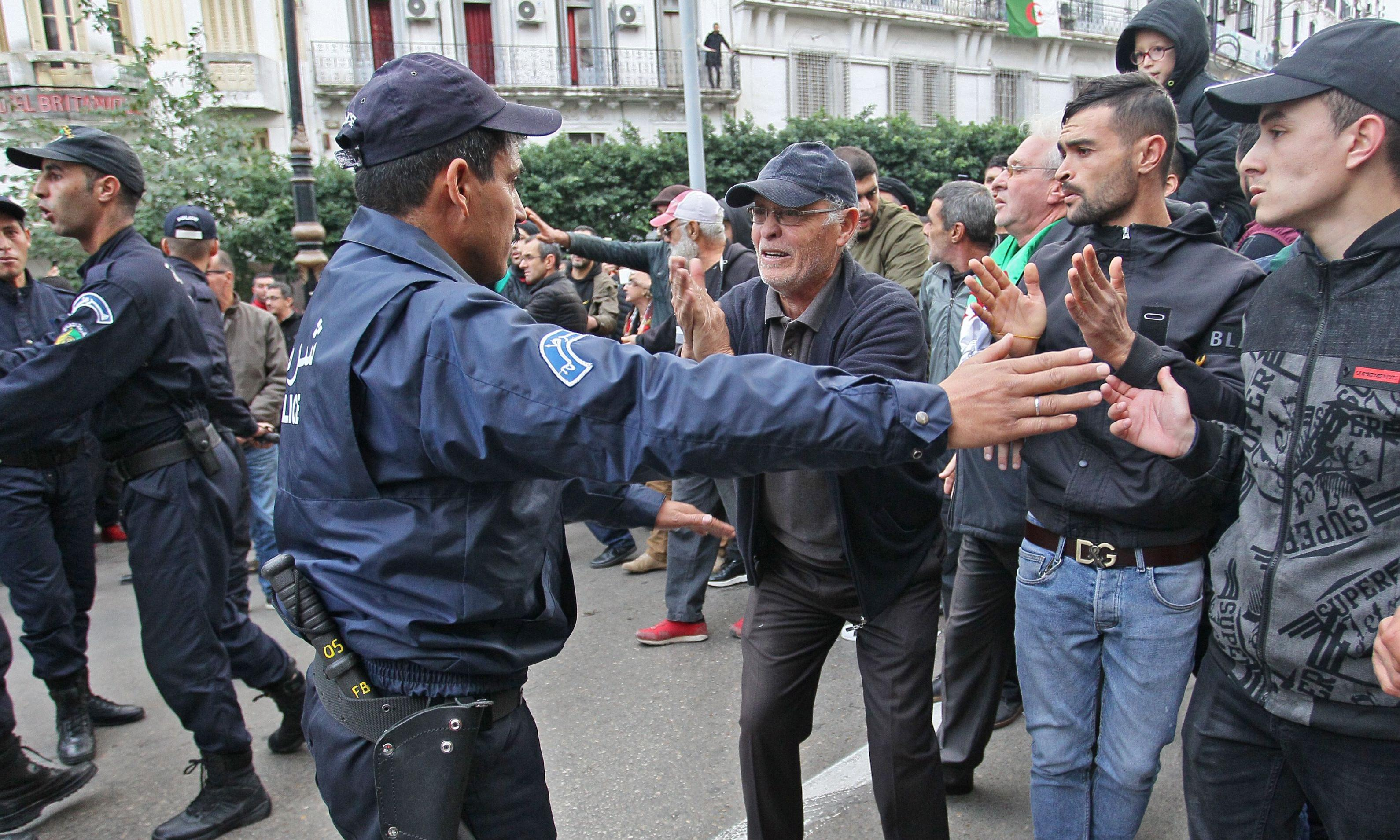 Mass boycott and police clashes as Algeria holds disputed election