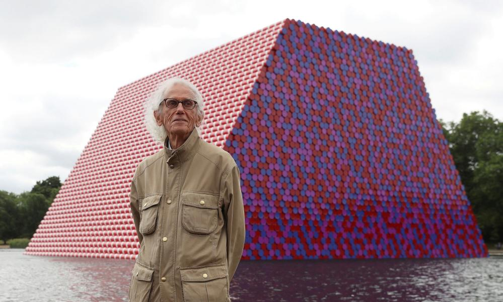 Christo stands in front of his work the London Mastaba on the Serpentine in Hyde Park, London, in 2018.