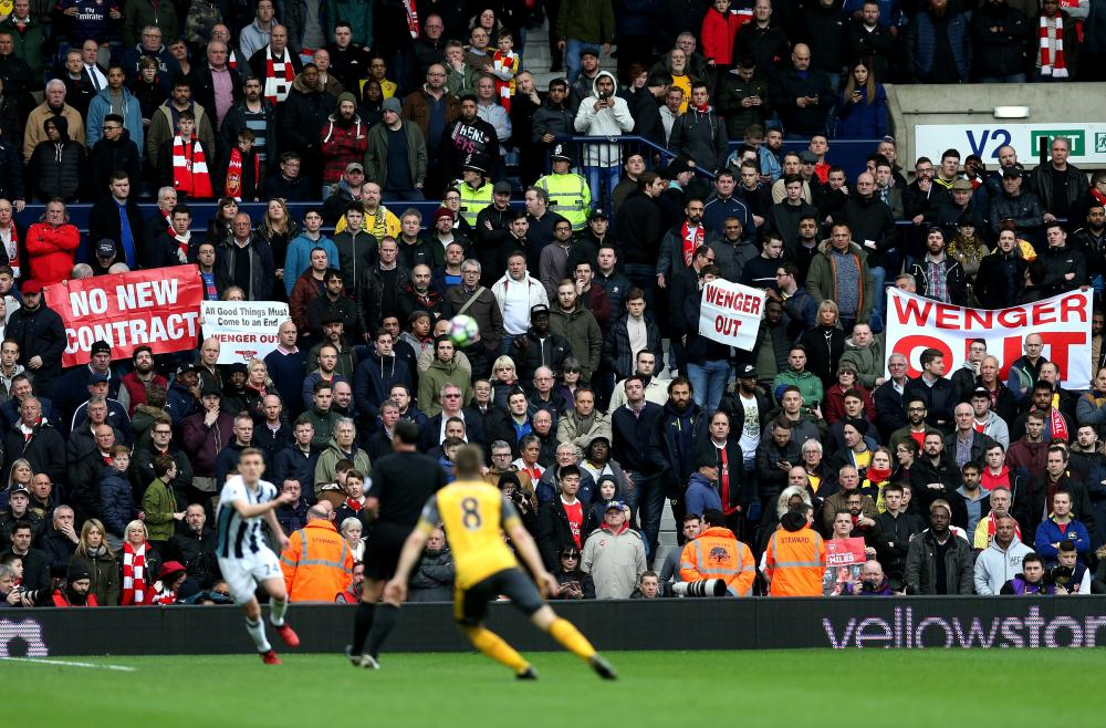 There were many anti-Wenger banners amongst the Arsenal fans at the Hawthorns.