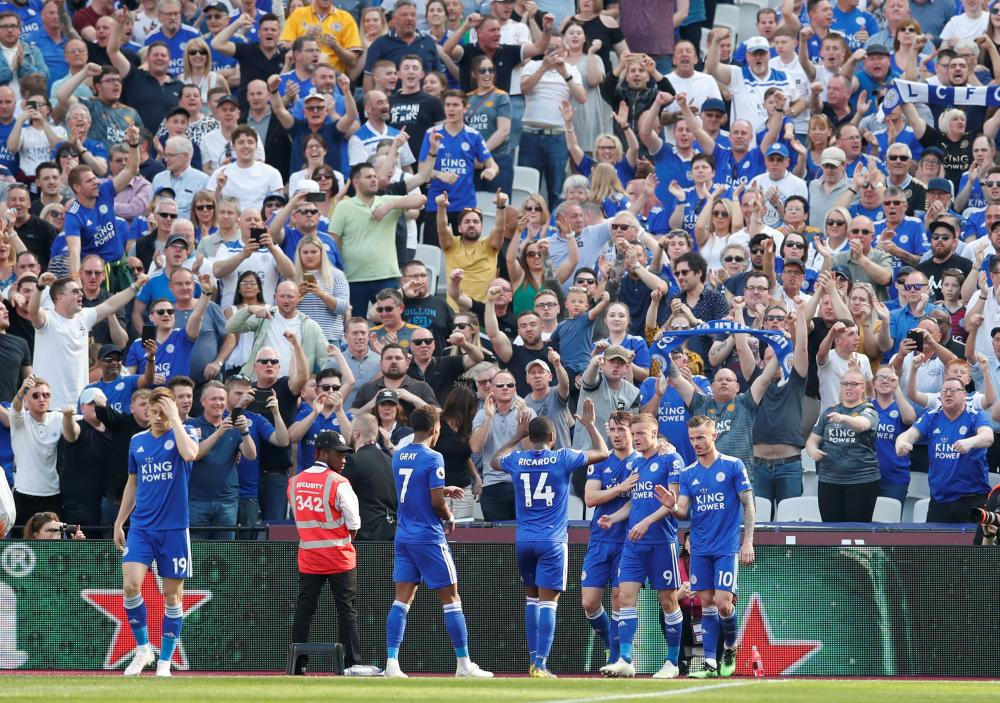 Leicester City's Jamie Vardy celebrates scoring their first goal with teammates.