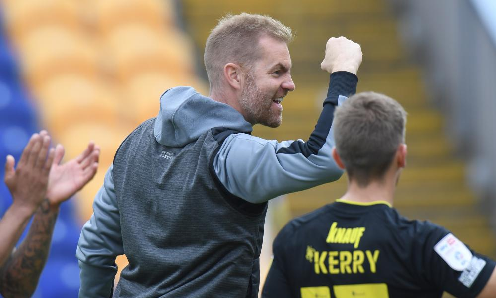 Harrogate's manager Simon Weaver enjoys the win over Mansfield last Saturday.