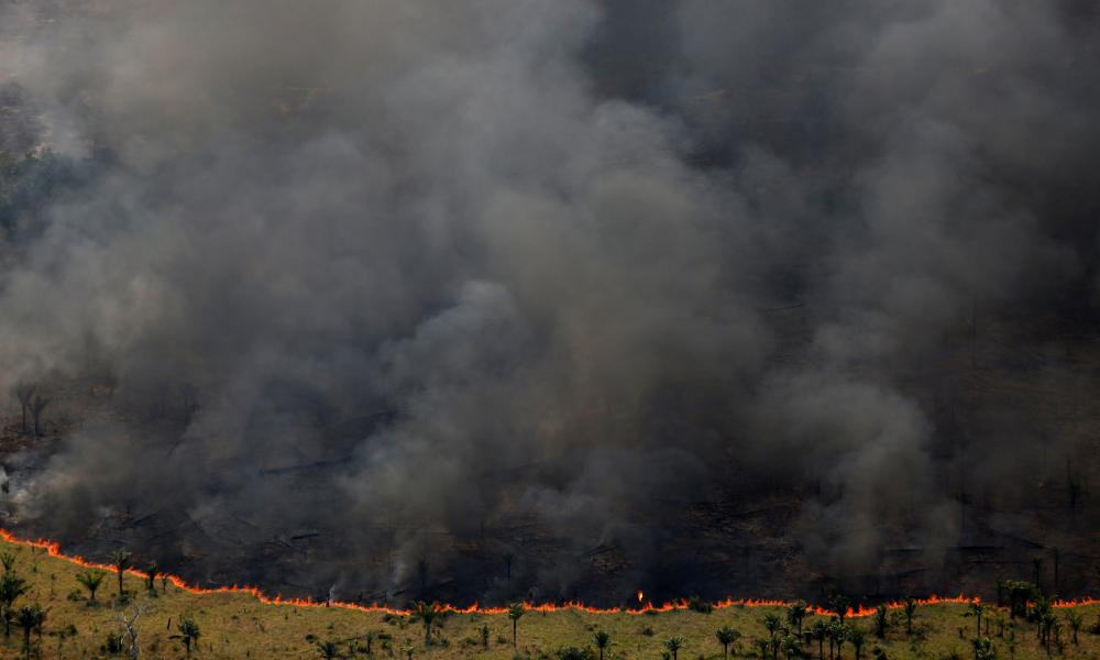 """Burning forest is seen during """"Operation Green Wave"""" conducted by agents of the Brazilian Institute for the Environment and Renewable Natural Resources, or Ibama, to combat illegal logging in Apui, in the southern region of the state of Amazonas, Brazil, August 4, 2017."""