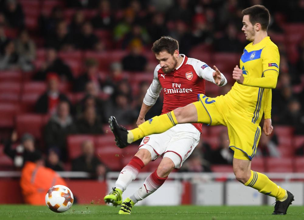 Mathieu Debuchy fires Arsenal into an early lead with a fine finish.