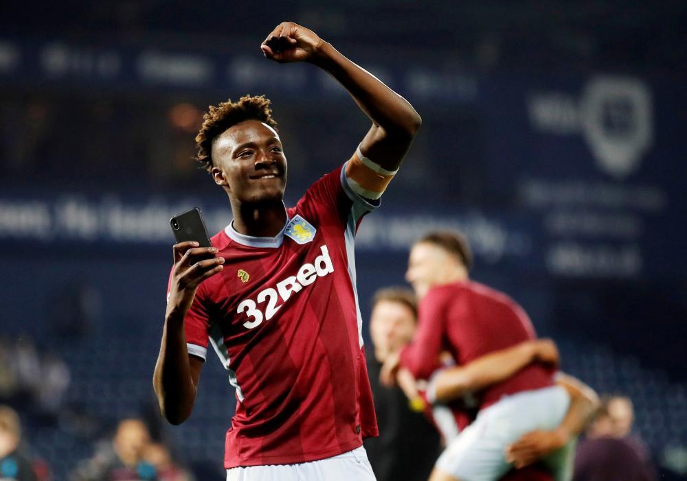 Aston Villa's Tammy Abraham celebrates after the match.