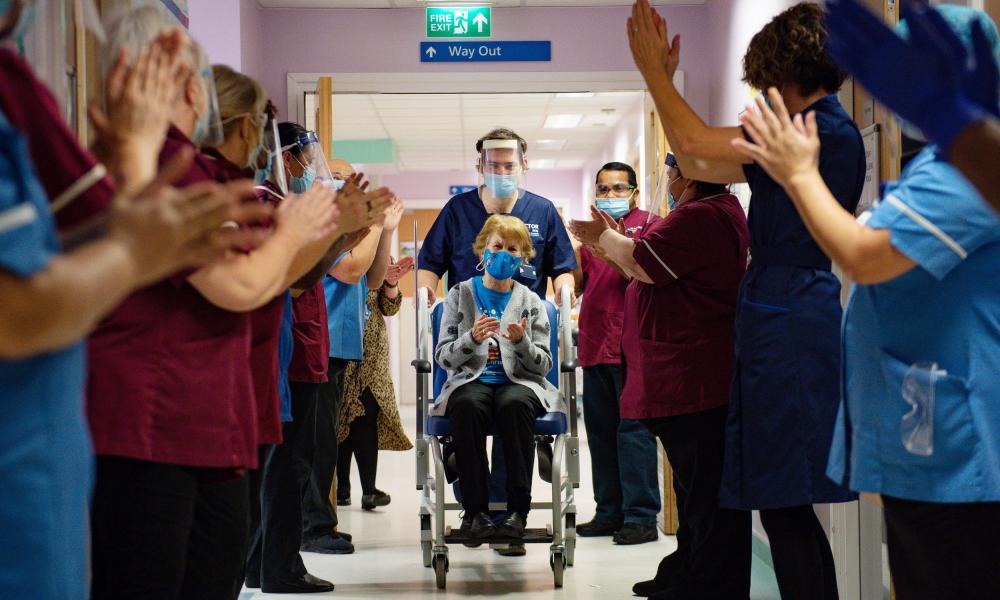 Margaret Keenan, 90, applauded by staff as she returned to her ward after she became the first person in the United Kingdom to receive the Pfizer/BioNtech covid-19 vaccine at University Hospital, Coventry