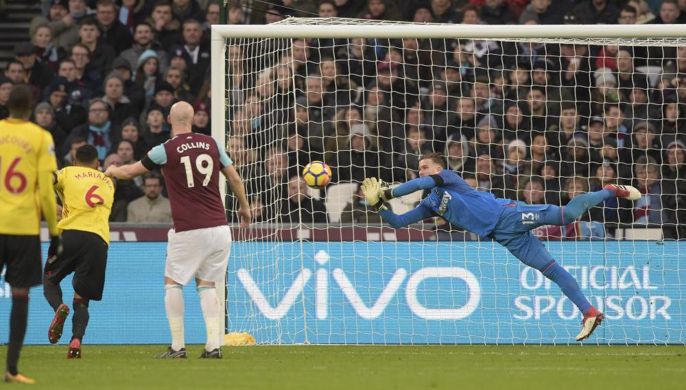 Adrián makes a save during the win over Watford.
