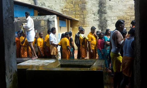 Pilgrims waiting in line to recieve the holy bath at the Ramanathaswamy Temple in Rameswaram, Tamil Nadu, India.