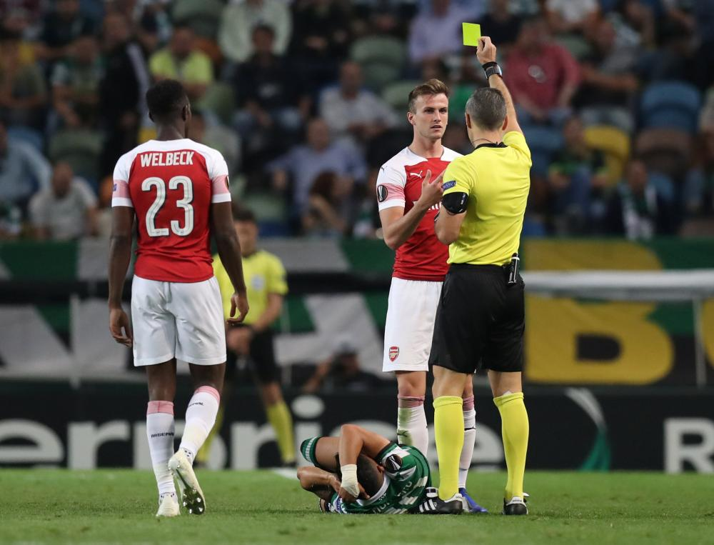 Holding is shown a yellow card by referee Damir Skomina.