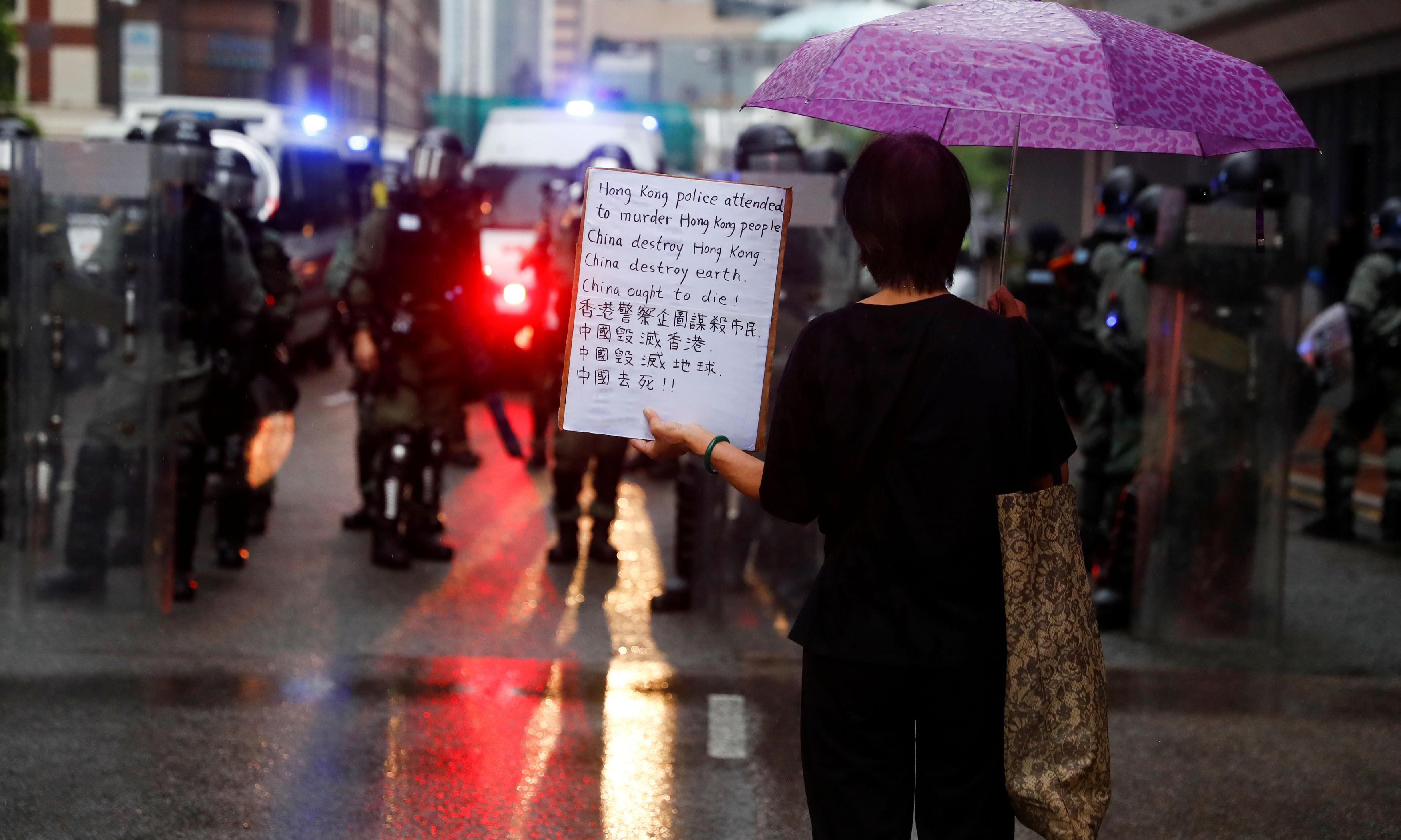 Hong Kong protests: police fire teargas at demonstrators in triad-linked district