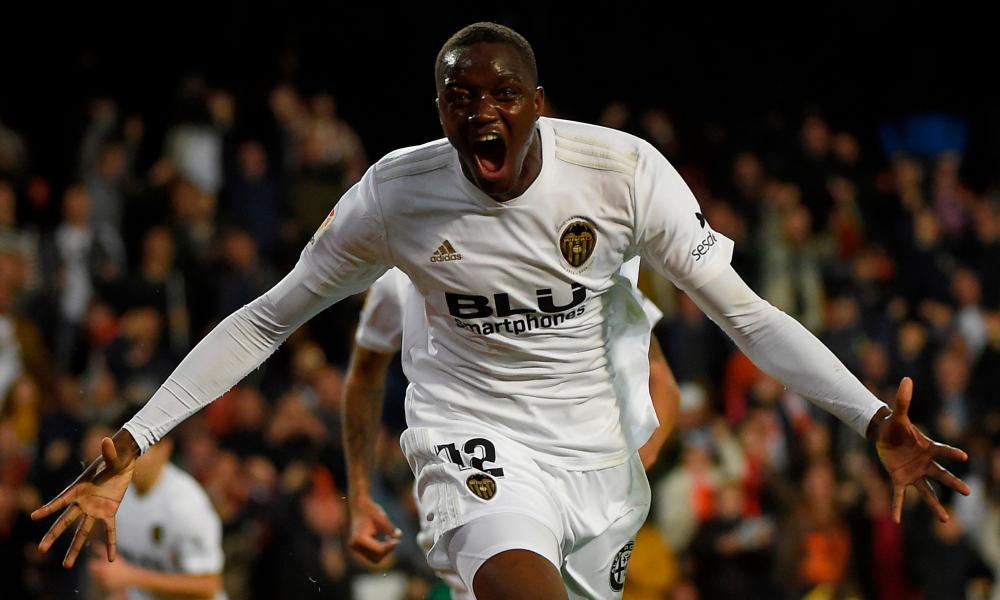 Mouctar Diakhaby celebrates his late equaliser for Valencia.