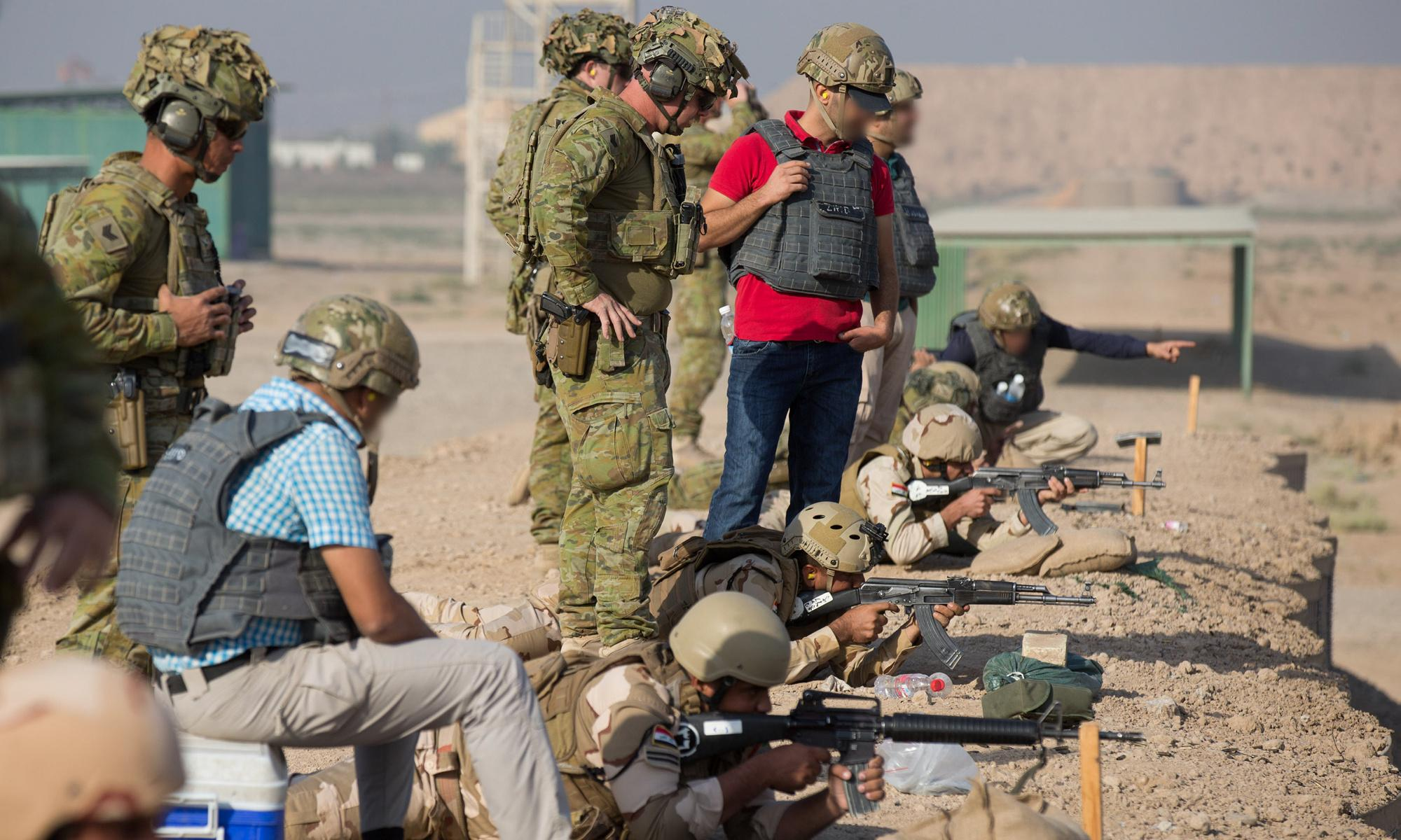 Iraqi interpreters who served beside Australians say they're prevented from applying for visas