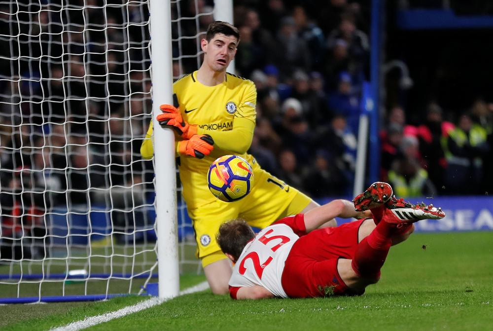 Thibaut Courtois makes the save from Dawson who is judged offside.