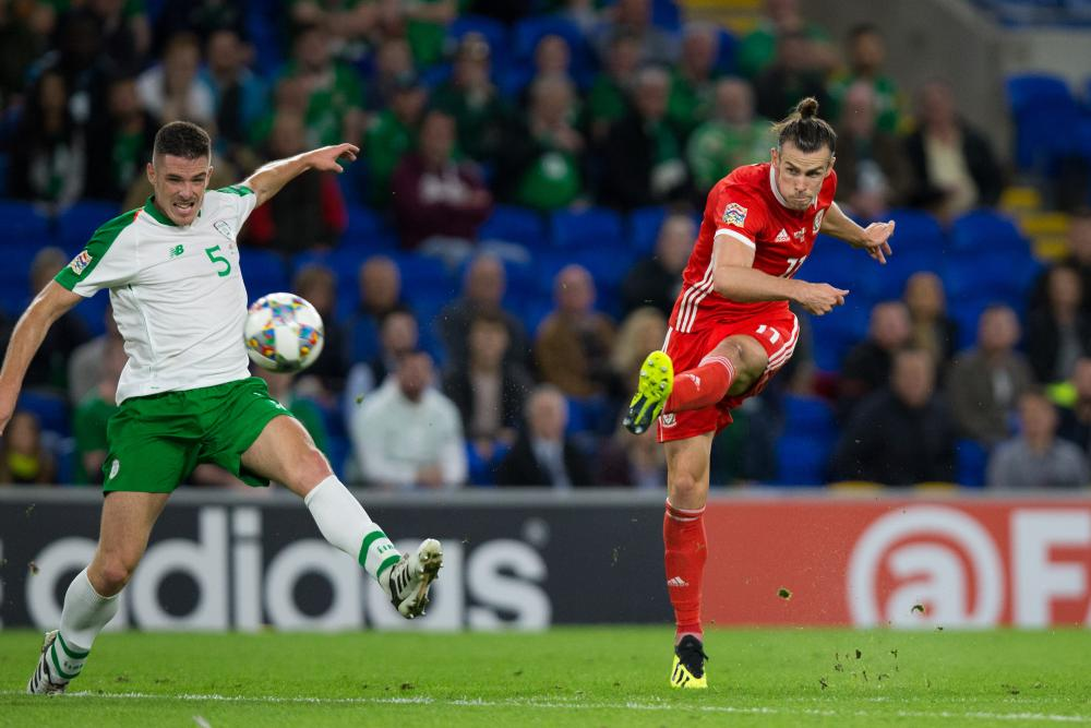 Gareth Bale fires in a fine finish for Wales' second.