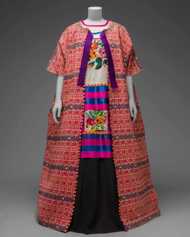 Guatemalan cotton coat worn with Mazatec huipil and plain floor-length skirt.
