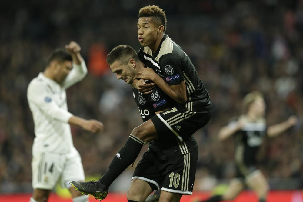 Ajax's Dusan Tadic, left, celebrates after scoring his side's third goal with fellow goalscorer David Neres.