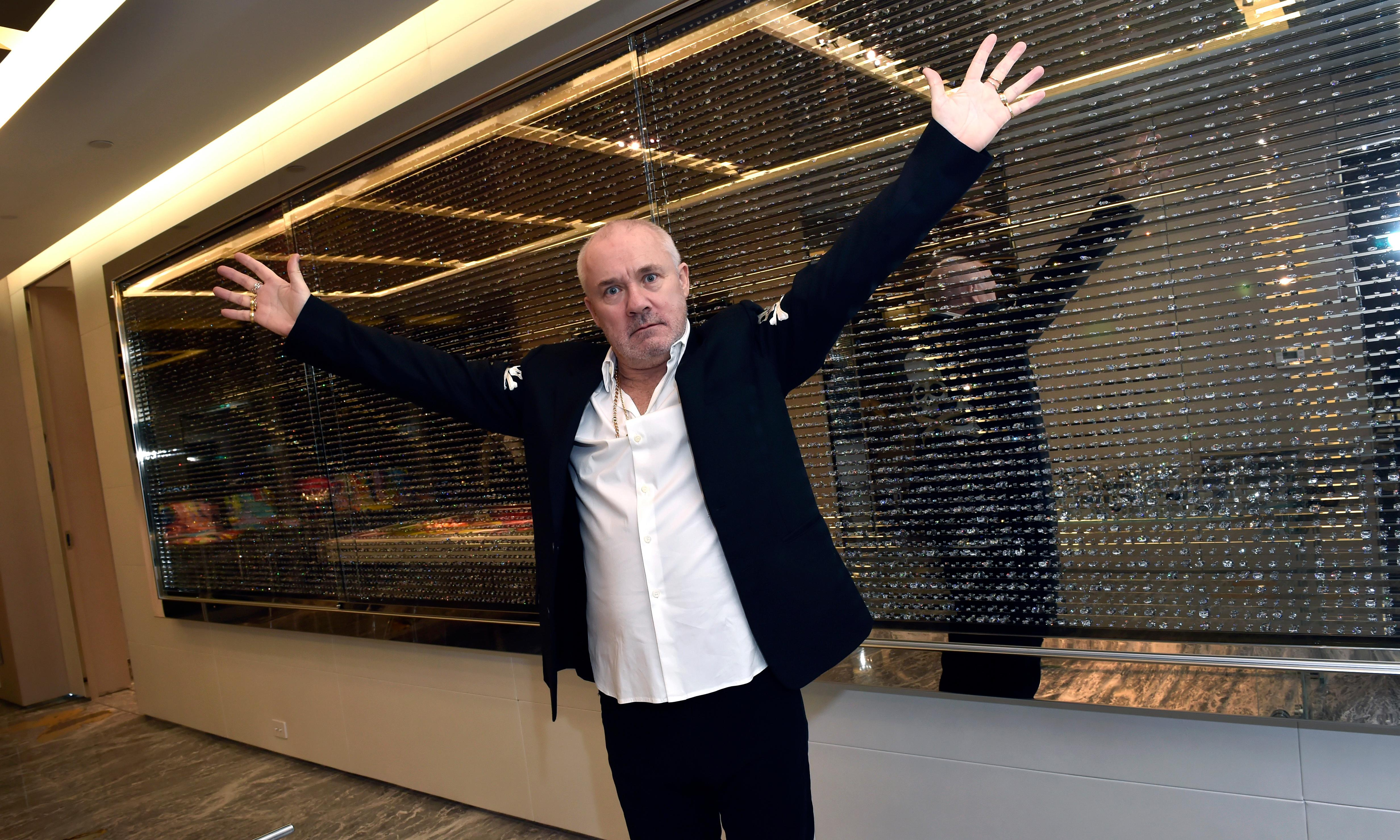 Damien Hirst's 60ft headless demon statue towers over new club in sin city