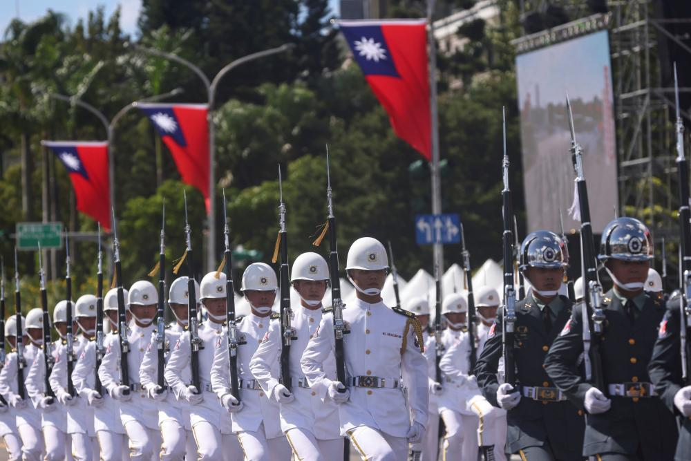 Soldiers march during the national day celebration.