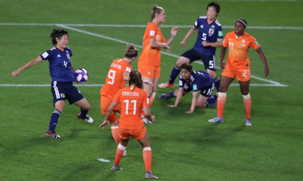 A shot by Netherlands' Vivianne Miedema hits the arm of Japan's Saki Kumagai (left).