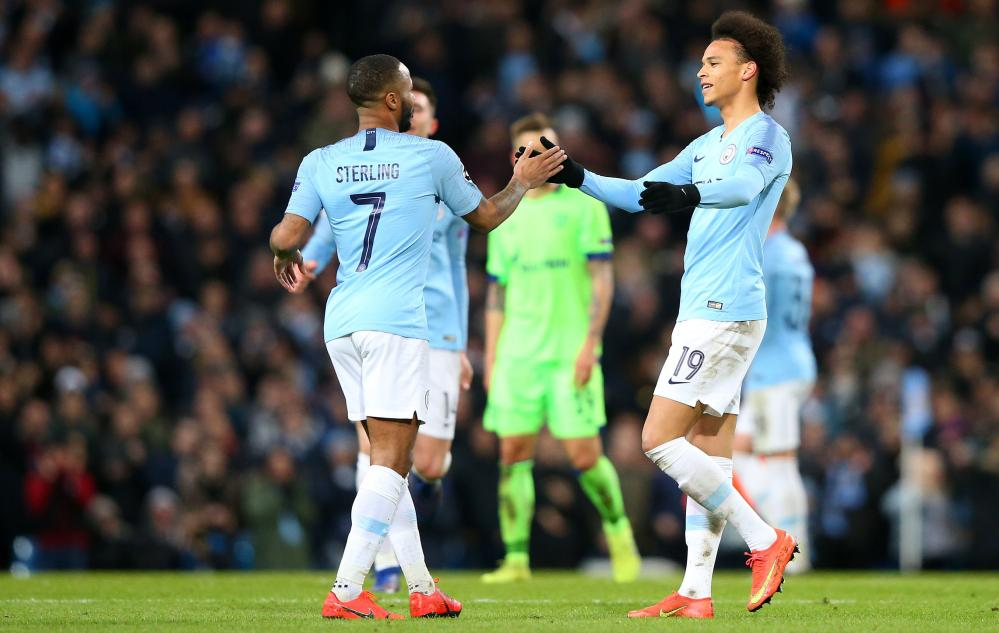 Raheem Sterling of Manchester City celebrates with Leroy Sane after scoring their fourth goal.