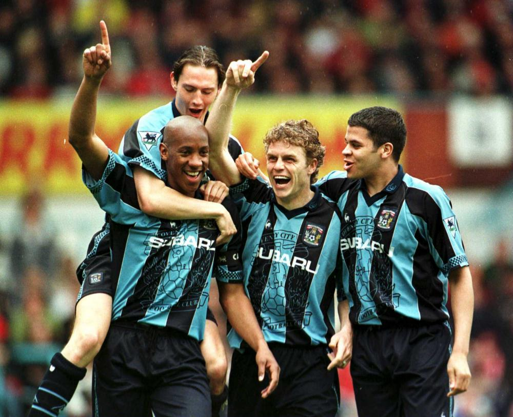 Dion Dublin celebrates scoring against Liverpool at Highfield Road.