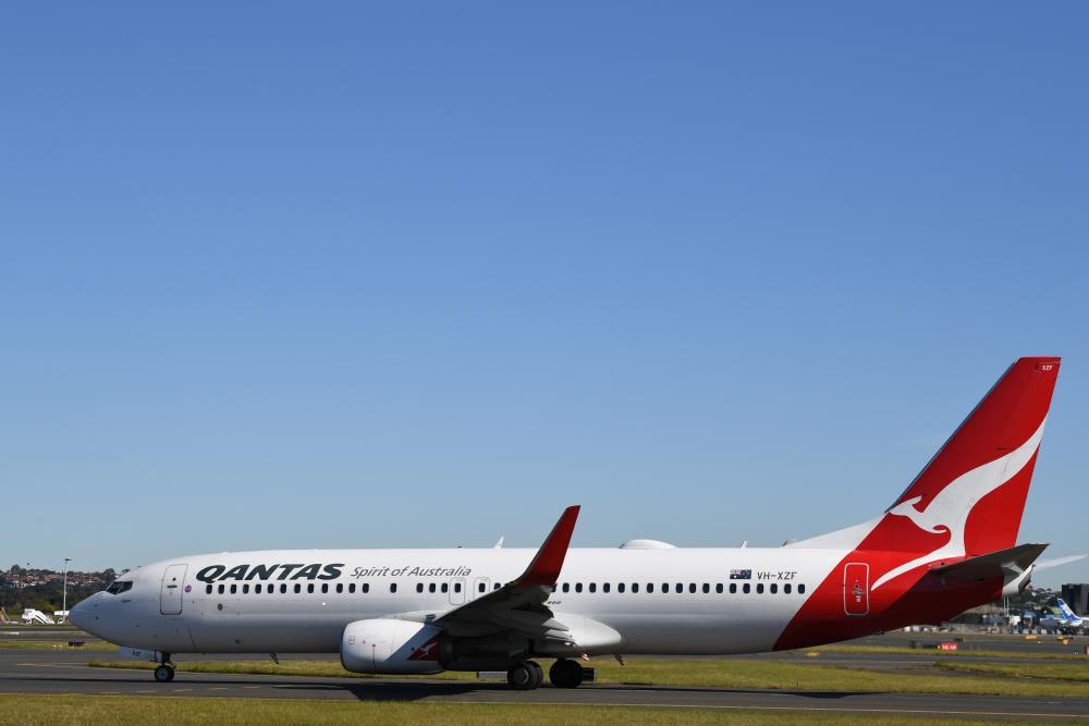 A Qantas Boeing 737-800 aircraft prepares to take off at Kingsford Smith International Airport.
