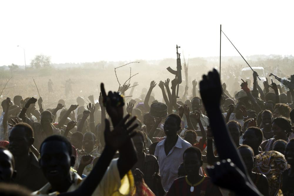 A Sudan People's Liberation Army (SPLA) soldier waves his AK-47, Malakal, South Sudan