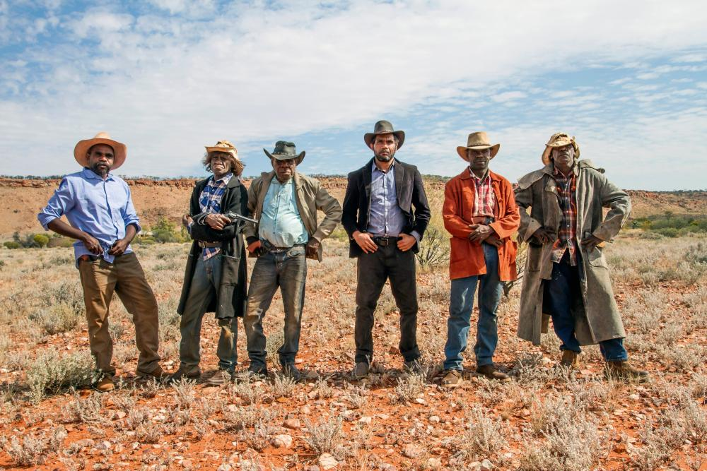 Patuway Mungkuri, Johnny Doolan, Peter Mungkuri, Vincent Namatjira, Michael Drover, and Kunmanara Andy star in Never Stop Riding.