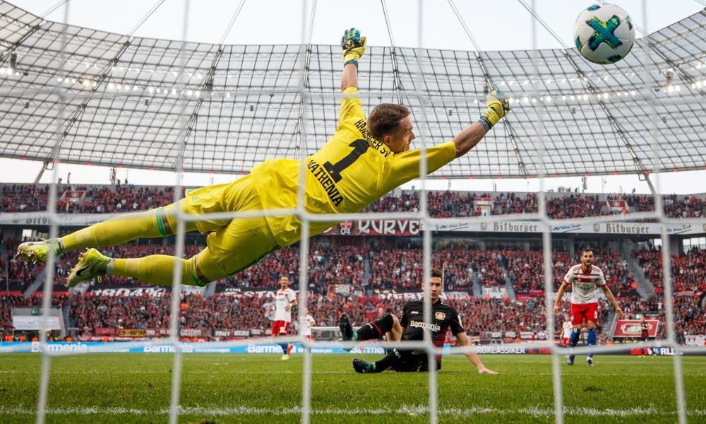 Lucas Alario scores Bayer Leverkusen's second goal against Hamburg, beating Christian Mathenia's despairing dive.