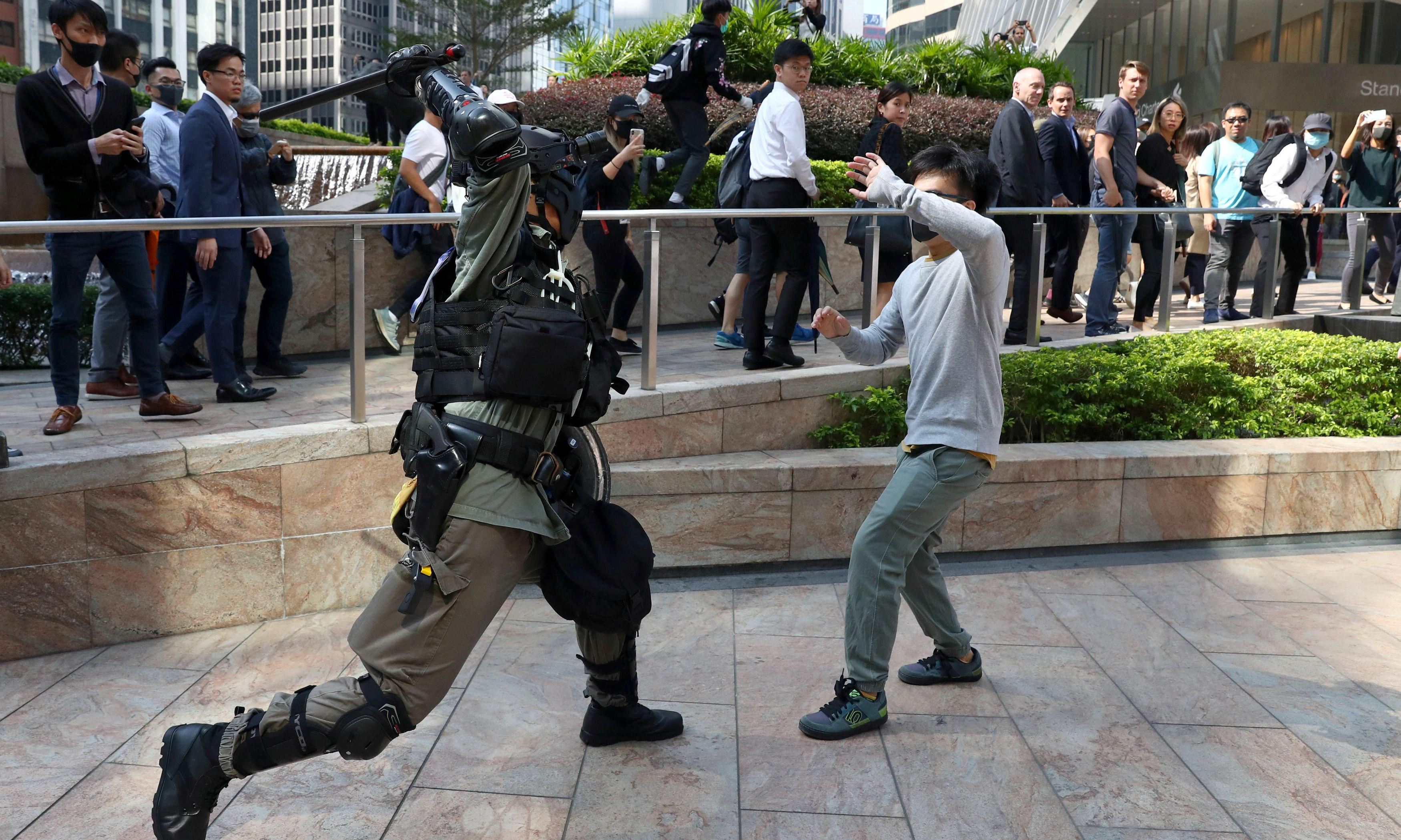 Hong Kong in chaos as protesters gather at universities with bows and arrows