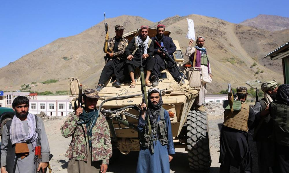 Taliban members pose for a photo after they claimed control of the Panjshir Valley. But there remains resistance in the valley. toTaliban rule