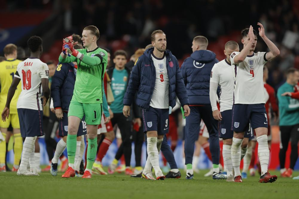 England players applaud the fans after the match.