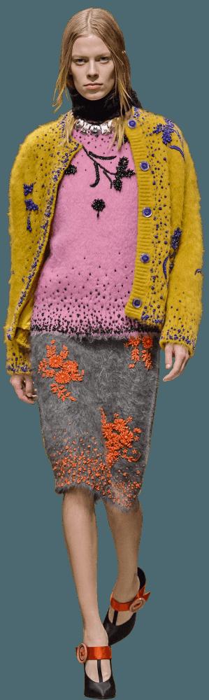 Model wearing Prada cardigan, jumper and skirt