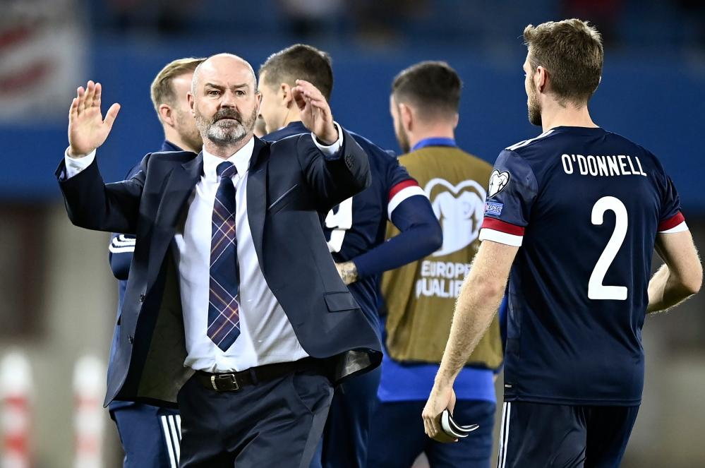 Scotland's manager Steve Clarke (L) celebrates with his players.