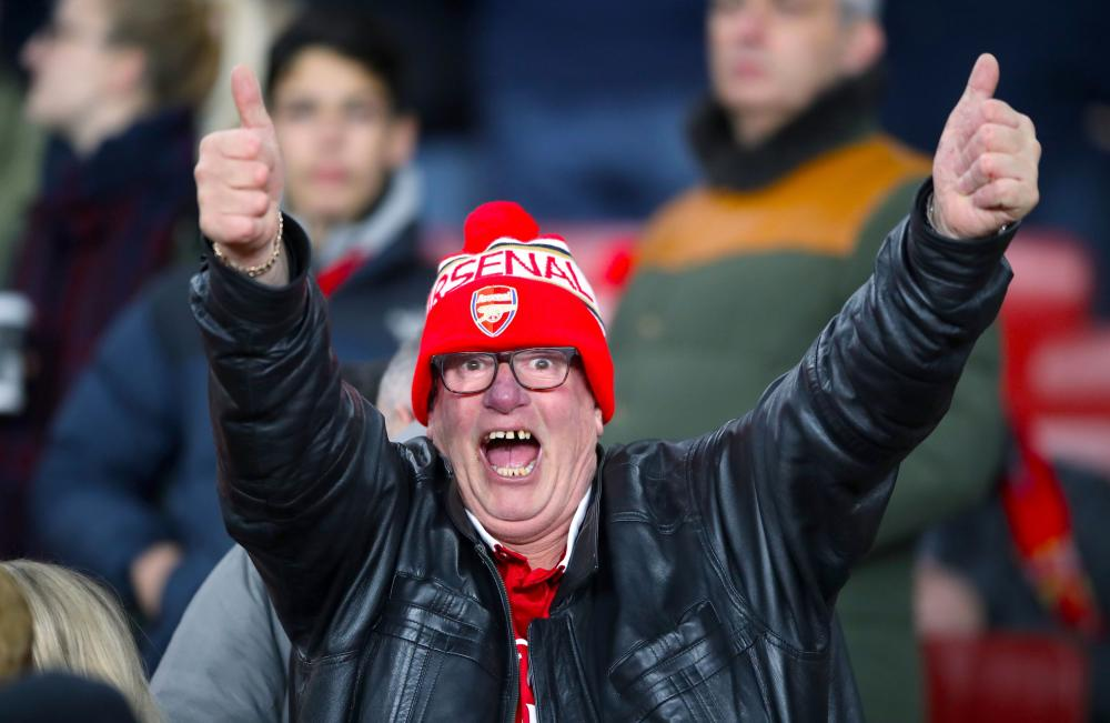 This Arsenal fan is pleased to be in the stands at the Emirates Stadium.