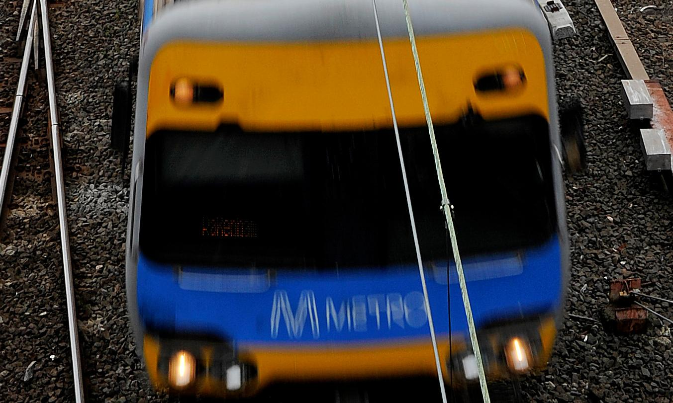 Melbourne crash: five people in hospital after train hits two cars