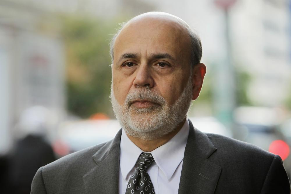 Key Economic Leaders Testify At AIG Trial<br>WASHINGTON, DC - OCTOBER 09: Former Chairman of the Federal Reserve Ben Bernanke arrives at U.S. Court of Federal Claims to testify at the AIG trial October 9, 2014 in Washington, DC. The trial is the result of a class action lawsuit brought against the US government by shareholders of AIG claiming that the government violated their rights by grabbing a majority stake in the company as part of the bailout of AIG in 2008. (Photo by Alex Wong/Getty Images)
