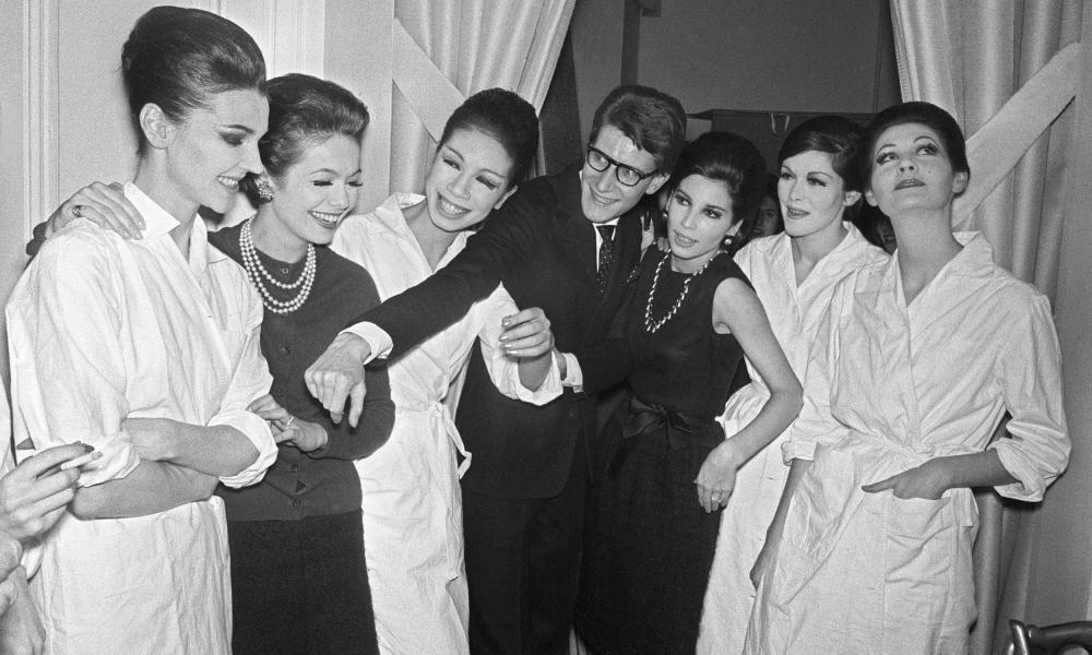Yves Saint-Laurent with Maison Dior after their premier show in Paris, 1962.