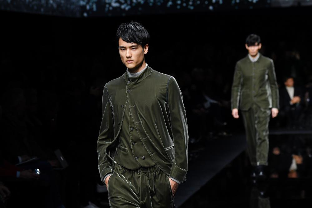 Models in green velvet Nehru suits