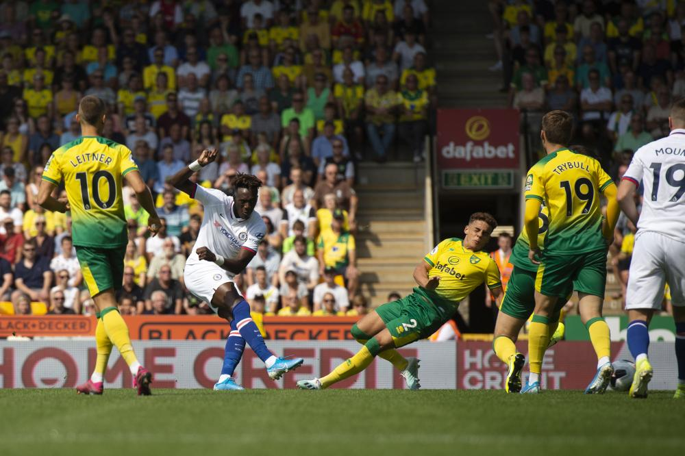 Tammy Abraham slots in the opening goal at Carrow Road.