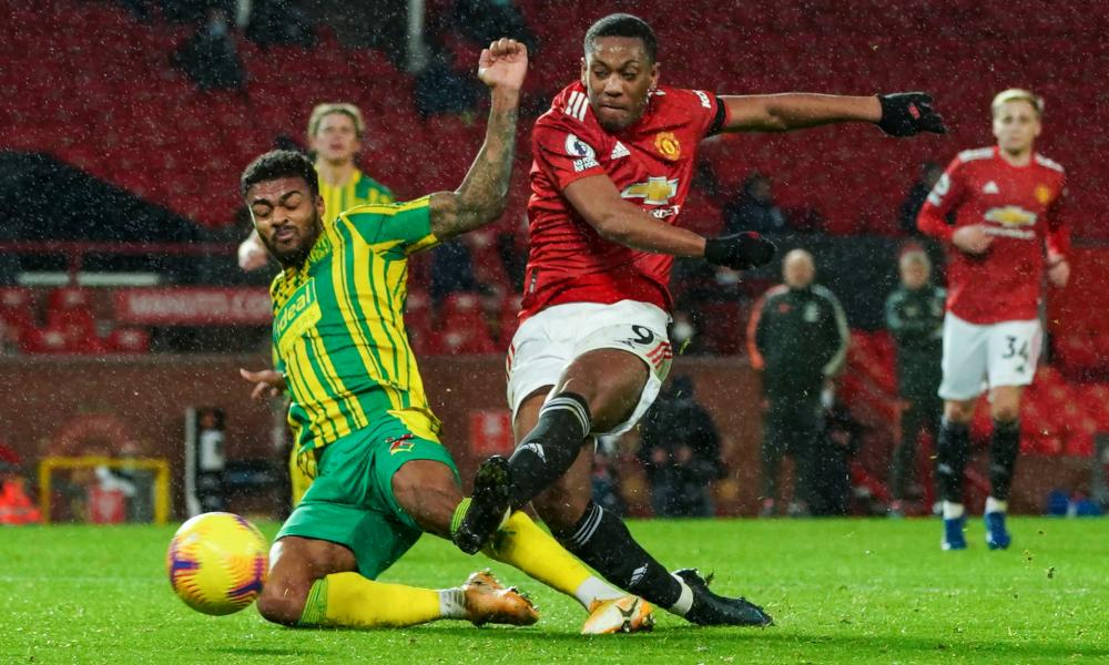 Darnell Furlong of West Bromwich Albion blocks a shot from Anthony Martial of Manchester United.